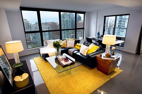 living-room-with-black-couch-in-contrast-with-a-yellow-rug